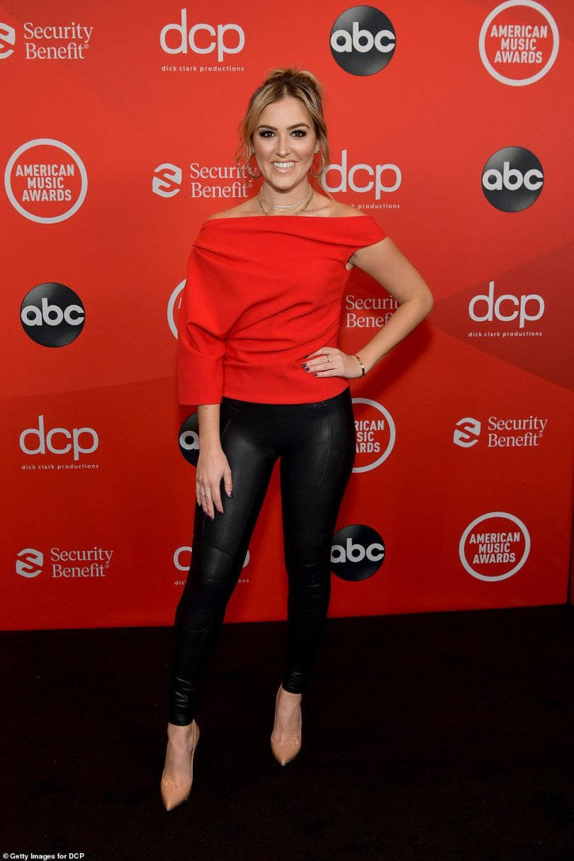 Best foot forward: Entertainment Tonight co-host Cassie DiLaura put her best foot forwards in a pair of nude pumps and some sexy black leather pants