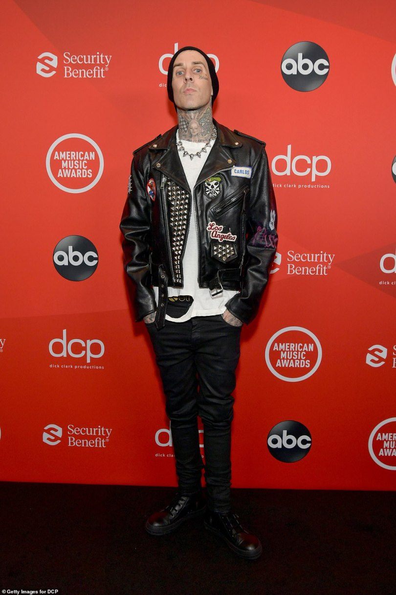 Rock and roll:Barker, who produced and played drums on Kelly's Billboard topping album Tickets To My Downfall, leaned on his rocker aesthetic in a decked out motorcycle jacket