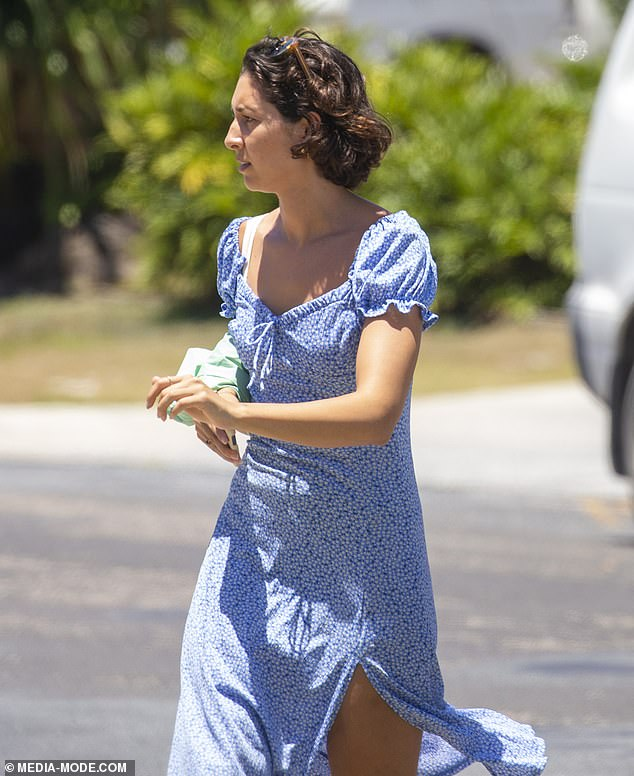 Summer style: She dressed her figure in a blue mid-length dress with a sweetheart neckline