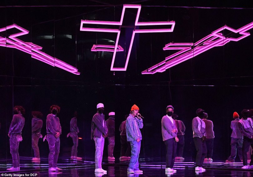 Seeing Jesus: The stage was then lit with a giant pink cross above his head, as he began to sing Holy, the first single from the untitled new album