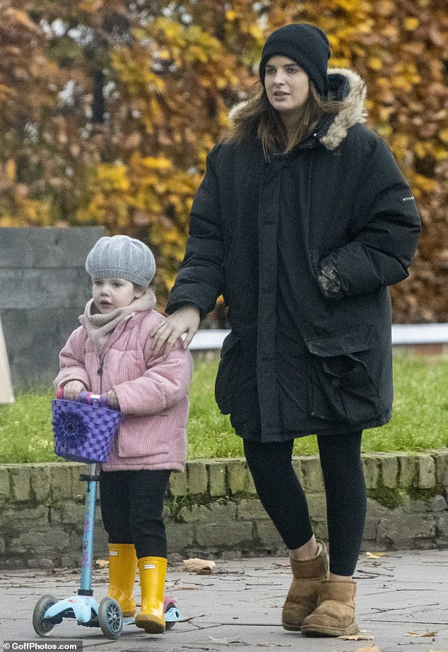 Binky Felstead and daughter India, 3, wrap up warm as they pick up breakfast in London