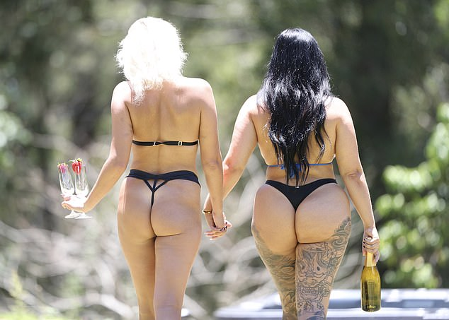 Cheers!  The glamorous duo, both 25, turned heads as they walked around in skimpy bikinis in the sultry shots