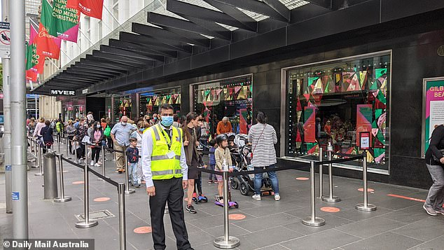 Families line up for a look at the Myer Christmas Windows on Tuesday