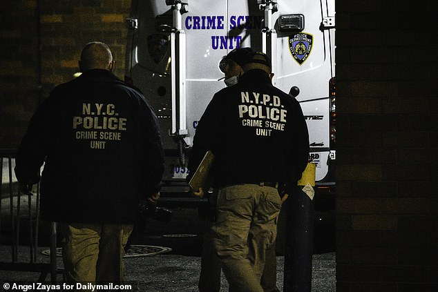 NYPD crime scene units were pictured at the scene of the shooting on Tuesday