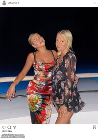 Sofia Richie poses with eyes shut and arm around bestie Abby Smidt on Bahamas getaway