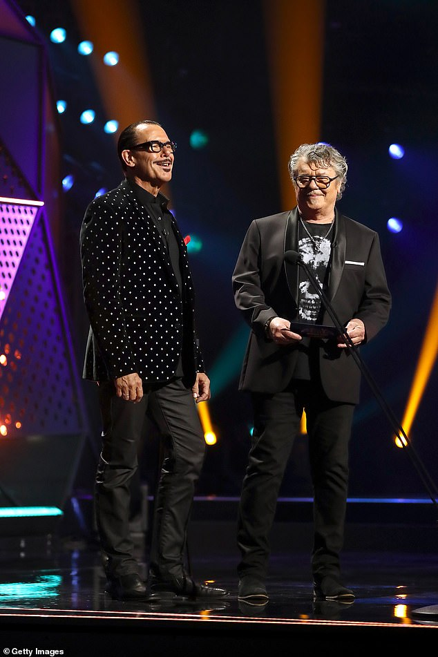 Rock royalty: Following Guy's win, Tim Farriss (right) and Kirk Pengilly (left) from INXS took to the stage to present the award for Best Group