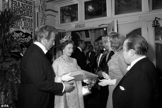 Queen Elizabeth II receives a record album, extracts from 25 years of Royal Variety Performance, from singer Vera Lynn in 1973