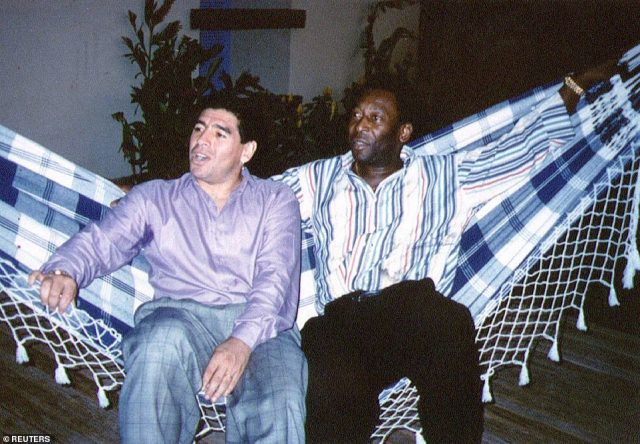 Soccer legends Diego Maradona (left) and Pele rest on a hammock during a reception in Rio de Janeiro, May 14, 1995.