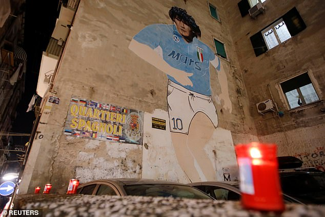 Maradona has another mural nearPiazza del Plebiscito where fans are flocking to in mourning