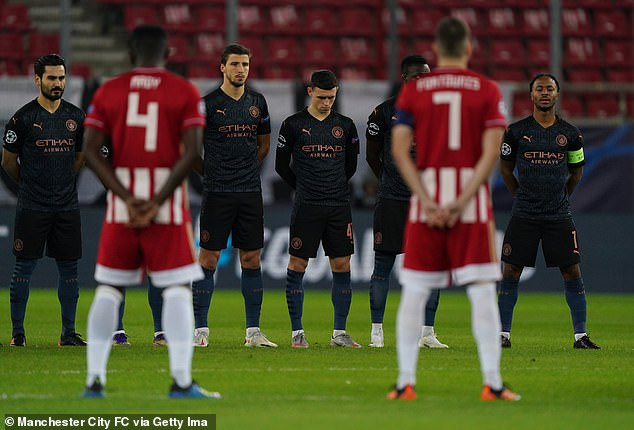 City's players take a moment to pay their respects before kick-off on Wednesday night