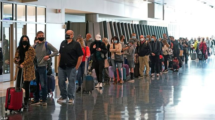 SALT LAKE CITY, UTAH: Passengers line up to go through a security checkpoint at Salt Lake City International Airport yesterday