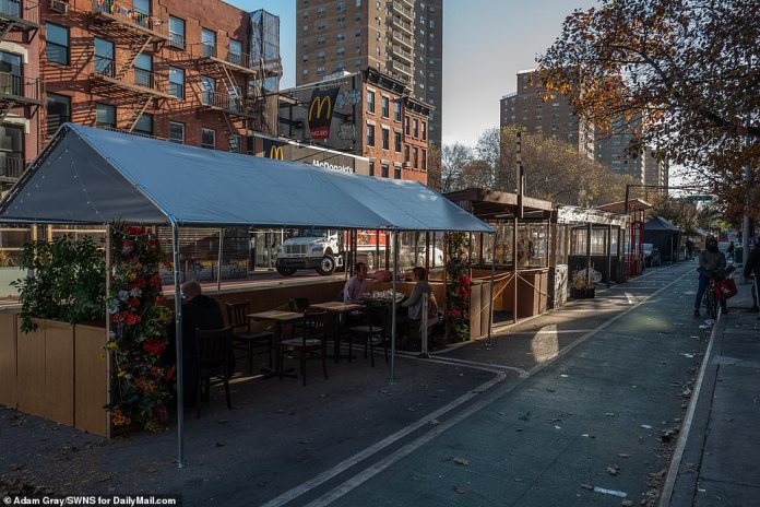 NYC: Diners enjoy a sunny day at a restaurant in East Village, Manhattan, on November 20