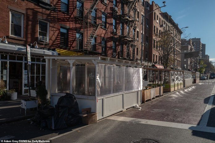 NYC: Back-to-back bungalows line a street in the East Village as restaurants adapt to cooler weather