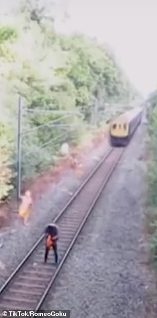 This oblivious worker had no idea a train was coming in his direction
