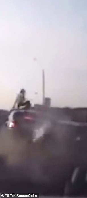 He landed on his feet on top of the car