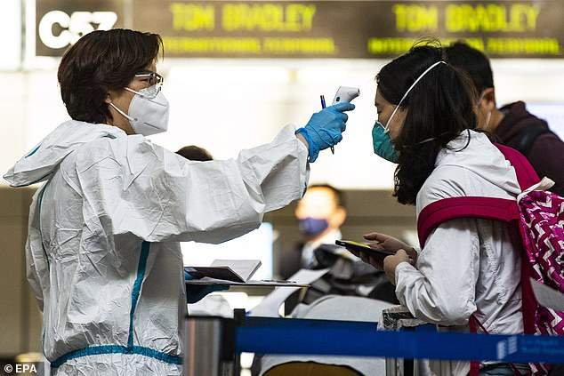 Travelers are screened and have their temperature checked by airline employees in LAX