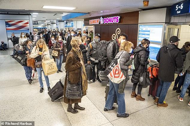 Thanksgiving travelers leaving Pen Station in New York on Wednesday