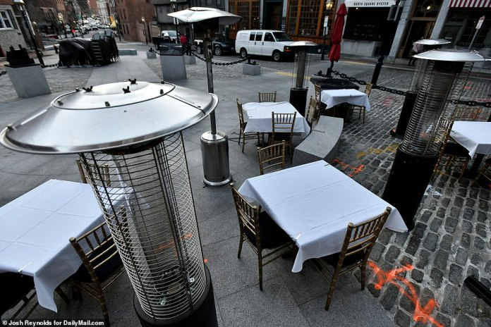 BOSTON: Heaters surround an empty patio in Boston's North End as restaurants struggle to bring in patrons in cold weather