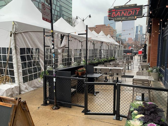 CHICAGO: The city's rules require restaurants to obtain permits for heaters and tents, which can only have 50 percent coverage on the side