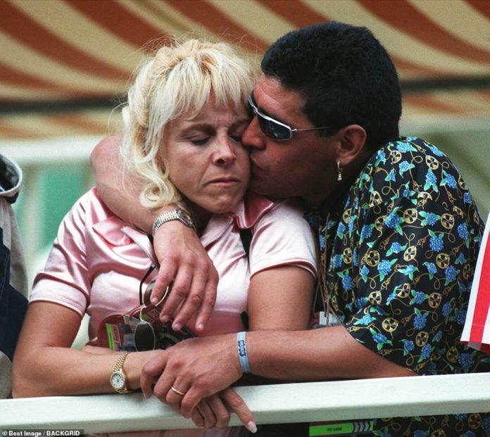 Maradona kisses his wife Claudia in an undated photo