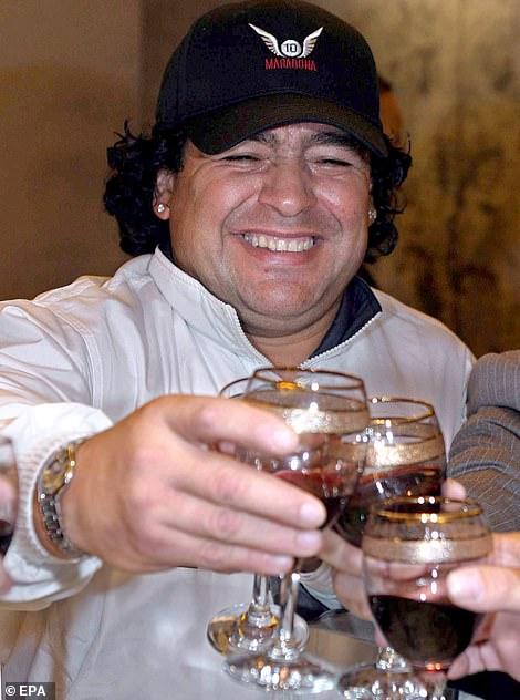 Maradona toasting with friends and business associates on a trip to China in 2003