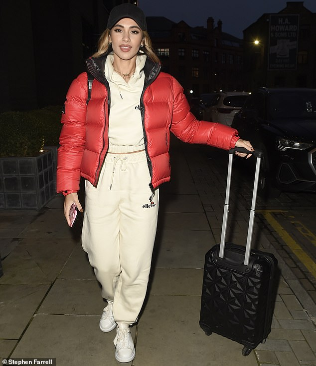 All in the details:Joanna completed the look with spotless white trainers and delicate gold jewellery