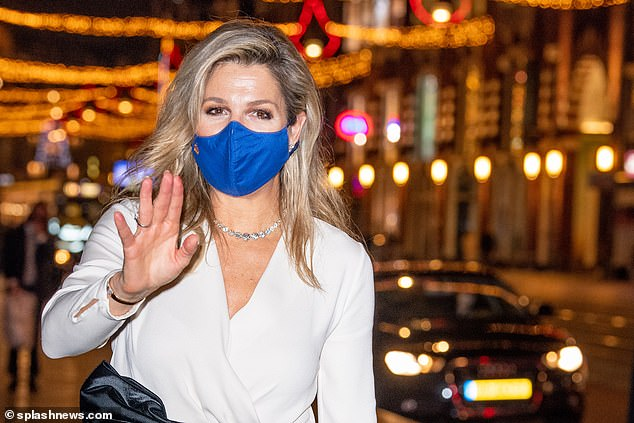 She oozed glamour in a black and white outfit paired with a bright blue face covering at the Beurs van Berlage in the centre of the city