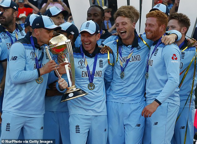Morgan (centre) helped England to World Cup glory on home soil last year at Lord's