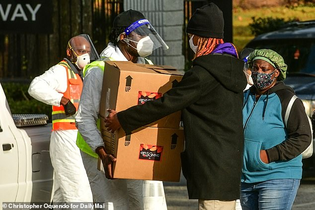 Helping hand:Earlier this week filmmaker and actor Tyler Perry stepped up to help the hungry with his annual Thanksgiving giveaway but had underestimated how dire the issue of food insecurity was in the Atlanta area