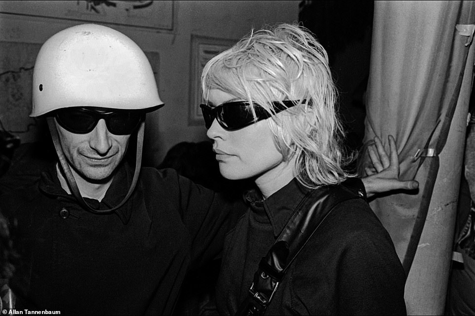 The Mudd Club was another legendary Downtown venue that artists and musicians frequented. It was open from 1978 to 1983 in Tribeca - at a time when the neighborhood was considered dicey. Tannenbaum explained there were theme party nights. Above, Victor Bockris and Debbie Harry at Combat Love, The Mudd Club, NYC, 1979. Combat Love was a party night with a military motif. Bockris, above with Blondie's Harry, is an author who has written several books