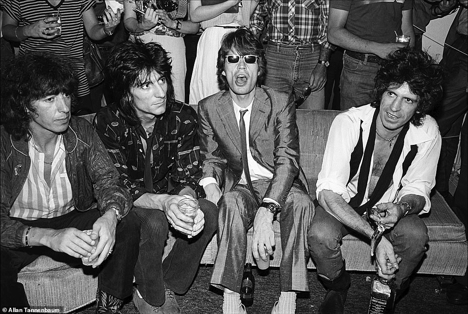 During the 1970s and '80s, photographer Allan Tannenbaum had access to the vibrant art, music and club scene in New York City. Working for the SoHo Weekly News, he was able to capture candid moments, like the image above, The Rolling Stones at Danceteria, NYC, 1980. The band - Bill Wyman, Ronnie Wood, Mick Jagger and Keith Richards - were at the trendy spot without drummer Charlie Watts. 'It had the cache of being cool,' Tannenbaum told DailyMail.com about Danceteria. The famed dance club, which was open from 1979 to 1986 at various locations, had DJs spinning for hours, a stage, and a crowd that included celebrities, artists, fashionistas and up-and-comers, like Madonna, who performed her debut single, Everybody, there in 1982