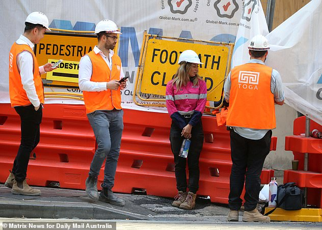 The nation's unemployment rate ticked up to seven per cent in October. Pictured: Construction workers