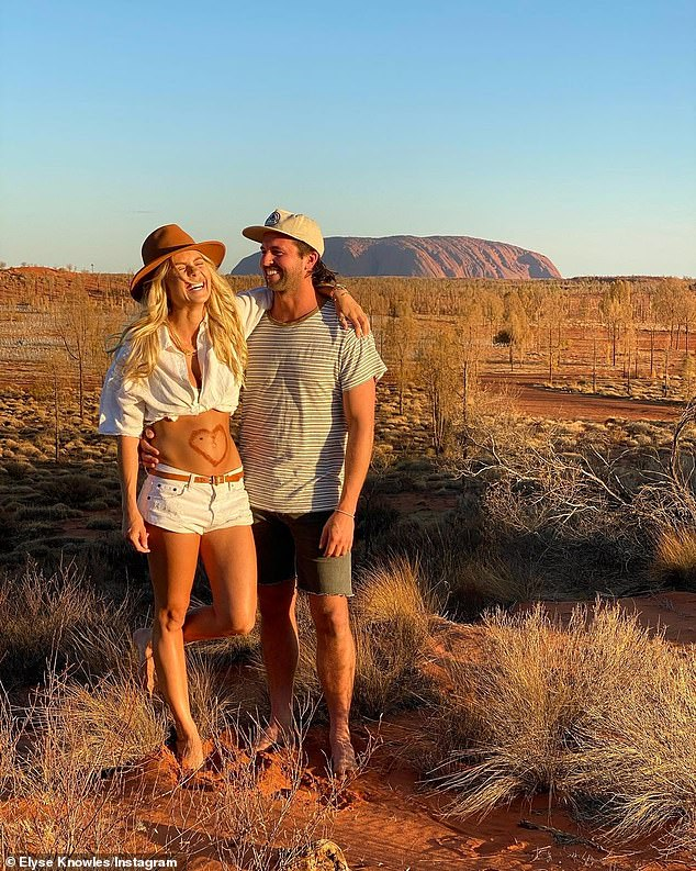 Baby on board:Elyse announced her pregnancy in September, sharing a series of loved-up photos to Instagram of herself and Josh, 31, in front of Uluru with a love heart drawn on her bare stomach