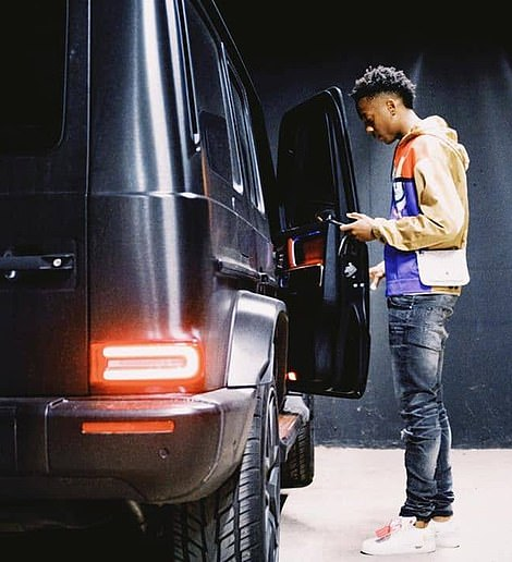 The £20,000-a-week star was recently pictured checking his phone as he stood next to a luxury vehicle