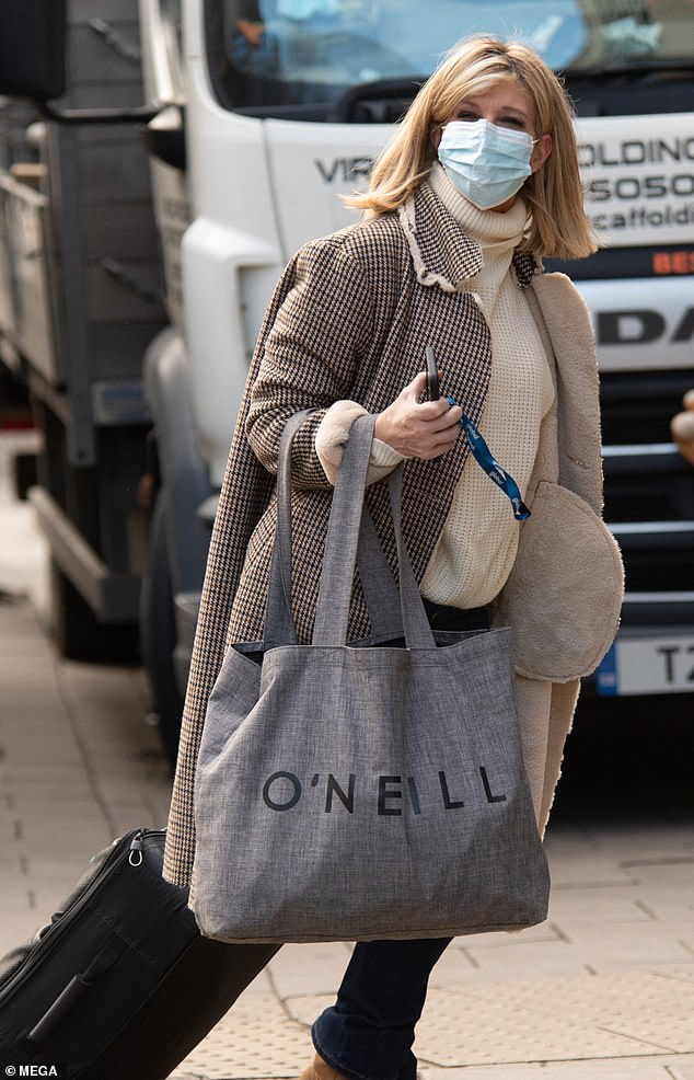 Low-key: The presenter, 53, looked typically chic as she wrapped up in a cream knitted jumper at the station's Global Studios
