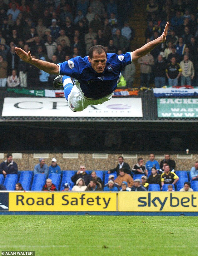 Kuqi shows off his trademark 'bellyflop' celebration after scoring a goal for Ipswich in 2004