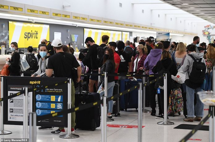 FORT LAUDERDALE, FLORIDA:Airline passengers are seen at Fort Lauderdale Hollywood International Airport on the eve of Thanksgiving