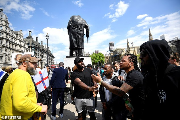 Statues of war-time Prime Minister Winston Churchill (pictured) and Indian independence campaigner Mahatma Gandhi were boarded-up amid fears of vandalism in the heat of protests earlier this year