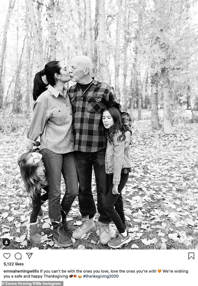 Sweet family:Bruce Willis's wife Emma shared a photo where she was kissing the Die Hard actor as they posed with their two kids. 'If you can't be with the ones you love, love the ones you're with. We're wishing you a safe and happy Thanksgiving'