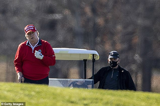 President Trump wore one of his signature red 'Make America Great Again' caps when he played golf on Thanksgiving