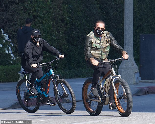 Staying safe Milligan sported a black windbreaker, coordinating leggings, a baseball cap and face mask