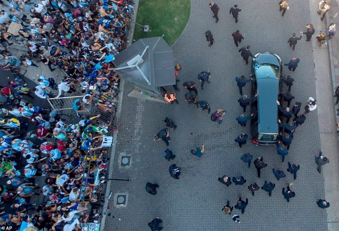The hearse carrying the casket of Diego Maradona leaves the government house in Buenos Aires