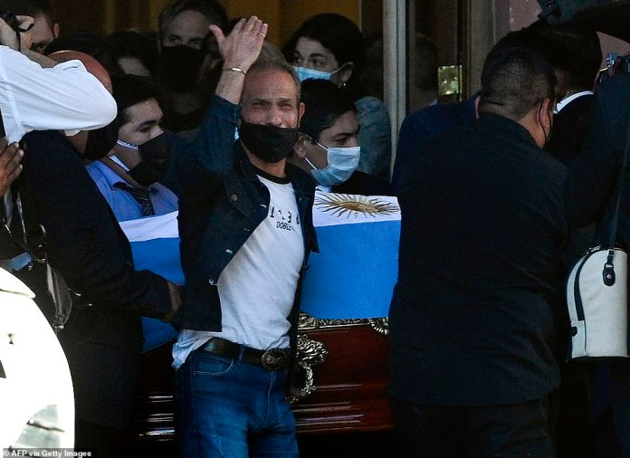 A close relative or a family member of Maradona gestures with tears in his eyes as he leaves the presidential palace with the coffin on Thursday