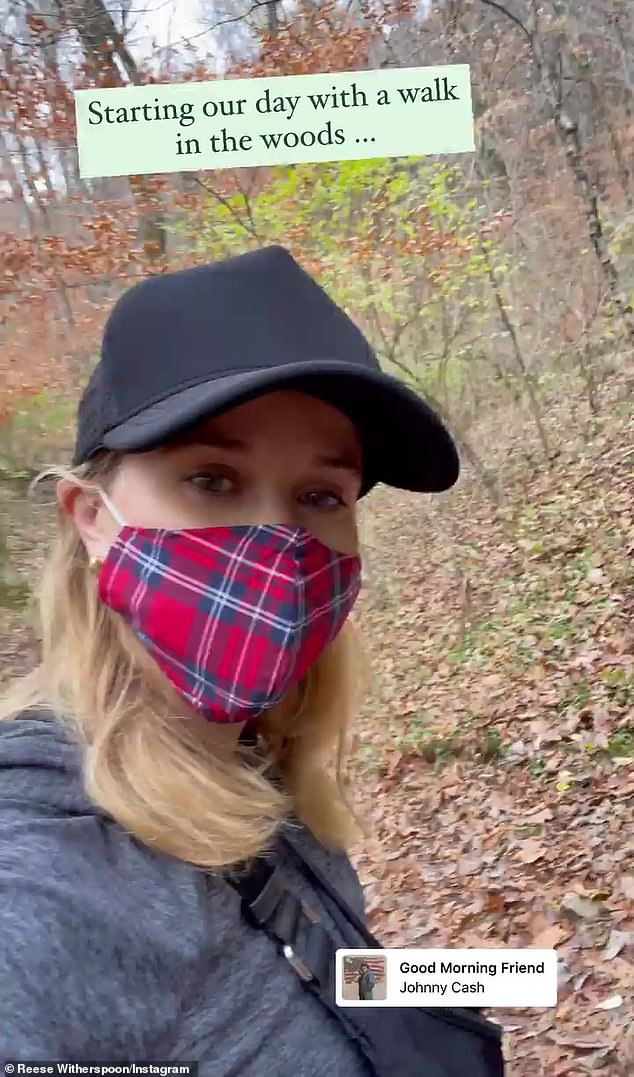 Early start: Witherspoonstarted her holiday with a walk with at least two of her four-legged family members; she added the Johnny Cash song Good Morning Friend to her video post