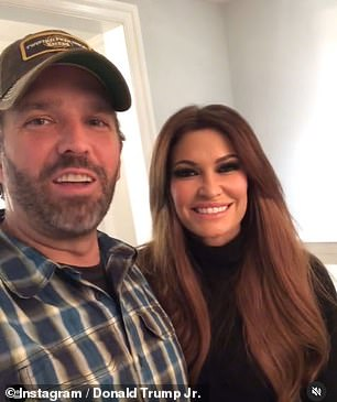 Donald Trump Jr (pictured with his girlfriend Kimberly Guilfoyle) said he was 'rona' free on Wednesday night
