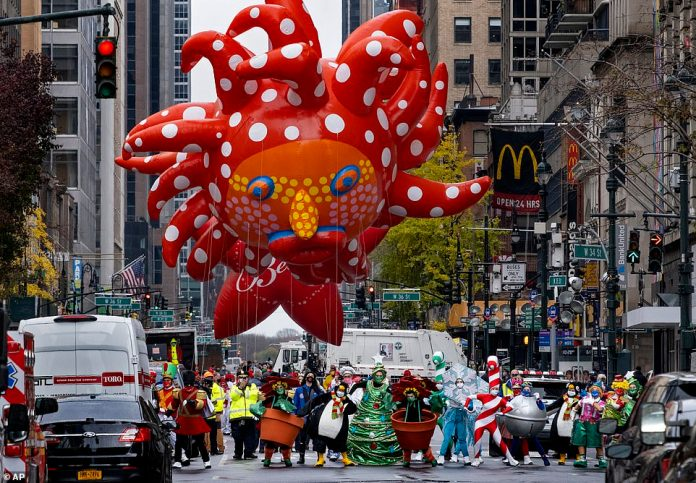 A large number of spectators were also confused over the appearance of a polka-dot clown balloon designed by female artist Yayoi Kusama, which was grounded during last year's parade due to high winds