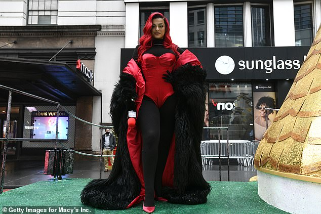 Strike a pose:The Say My Name hitmaker, 31, slipped into a red corset body and a black furry coat as she took to the Big Turkey Spectacular float at the scaled back event in New York