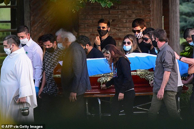 His coffin, draped in an Argentinian flag, was carried by his family and friends at his funeral at the Jardin Bella Vista cemetery, in Buenos Aires on Thursday