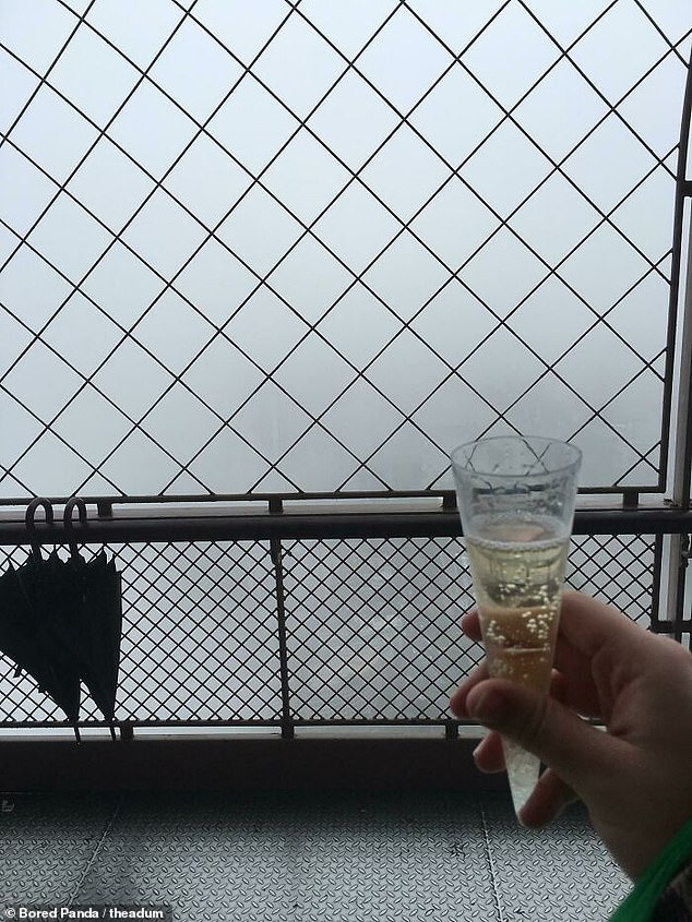 Not so gay Paris! One person reached the top of the Eiffel Tower on their honeymoon only to be greeted by this foggy 'view'