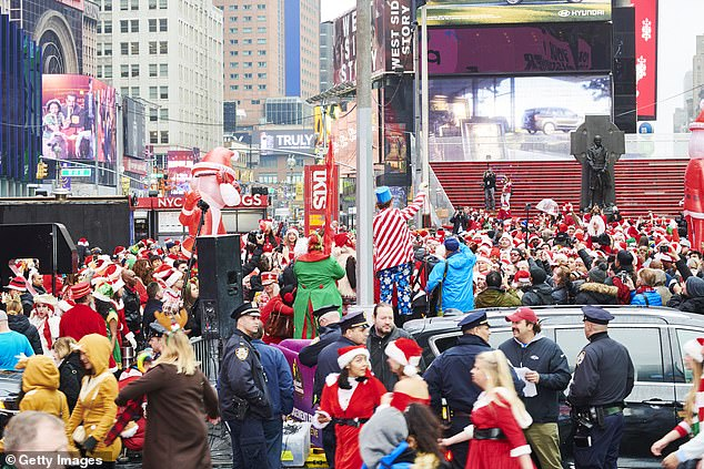 People dressed as Santa Claus gather at Father Duffy Square for SantaCon in 2019